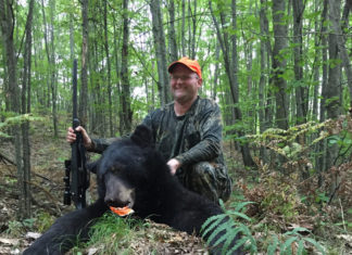 Jake Asker, a successful 2018 bear hunter in the Baldwin Bear Management Unit with this Lake County bear.